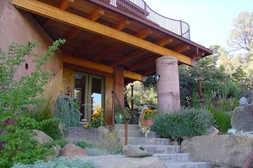 Front entry to a Poured Earth home in Prescott, Arizona, with family cat on the steps