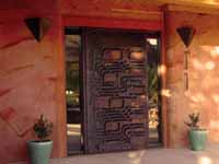 Picture of entry door and sustainable, high mass poured earth walls